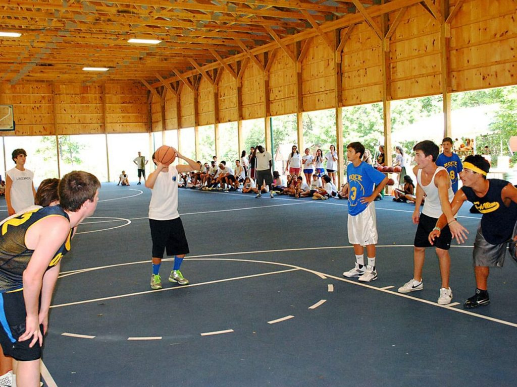 boy campers playing basketball