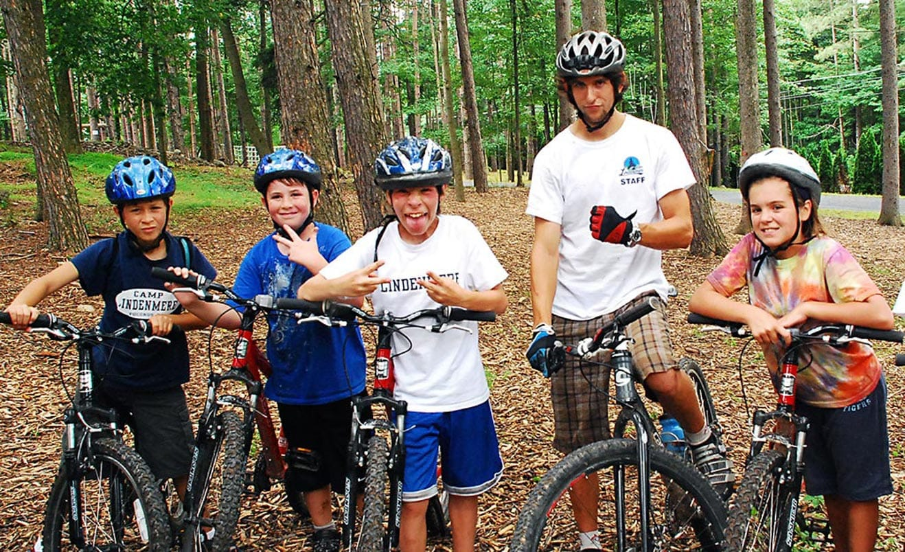 Campers on mountain bikes smiling
