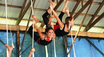 campers and staff doing circus and aerial gymnastics