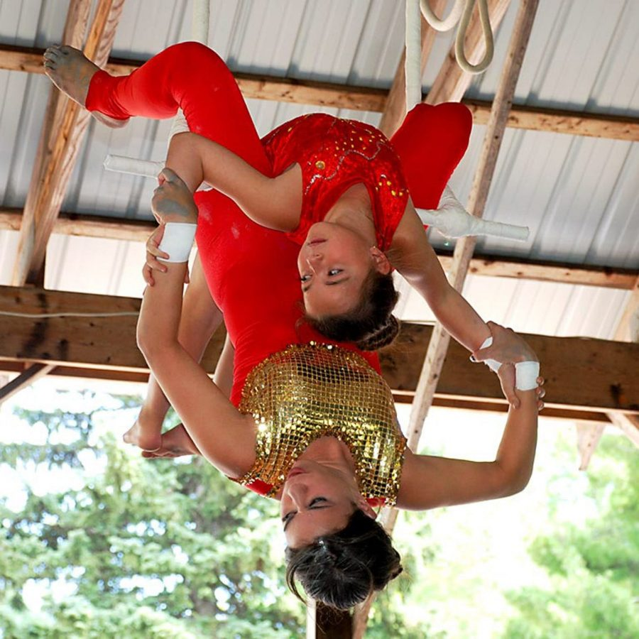 camper and staff doing aerial circus tricks