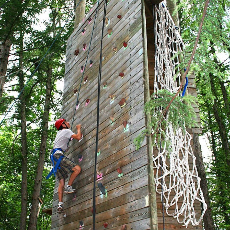 Male camper on climbing tower