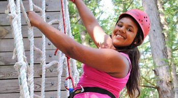 girl camper climbing tower
