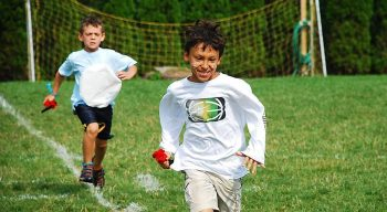 Boys running during color war