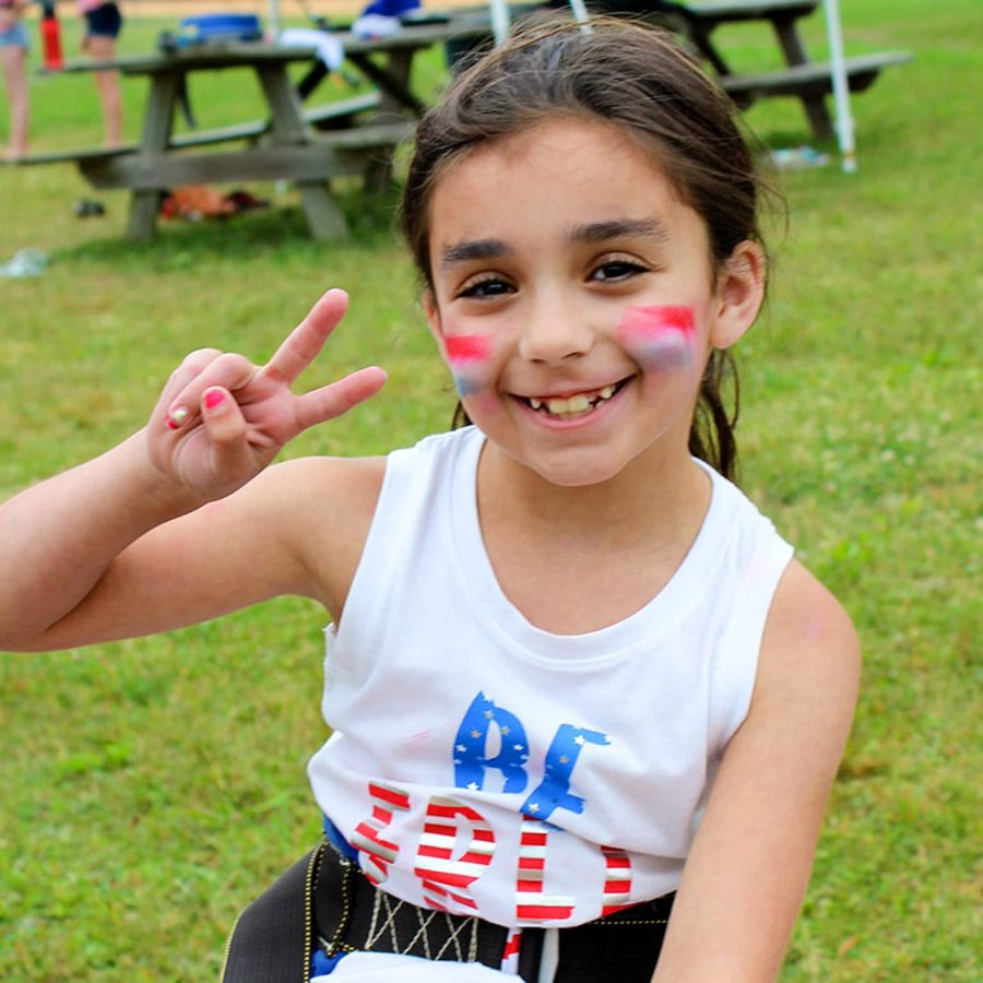 young girl camper with facepaint
