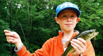 boy camper fishing
