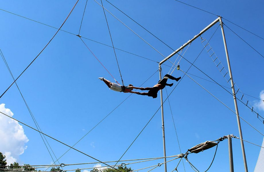 Campers on flying trapeze
