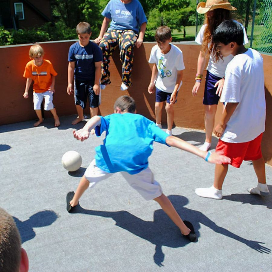 Male campers playing gaga