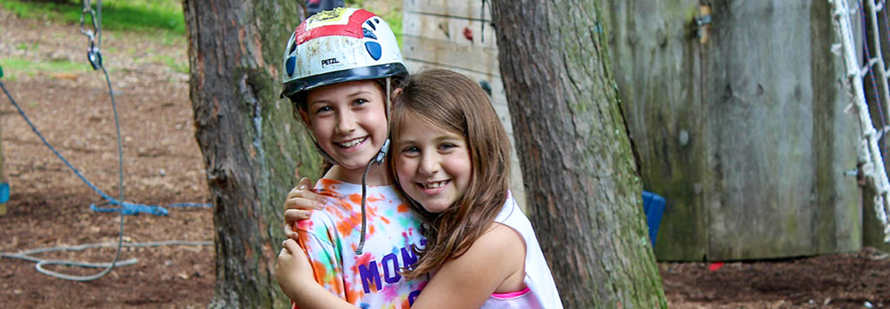 girl campers by climbing tower