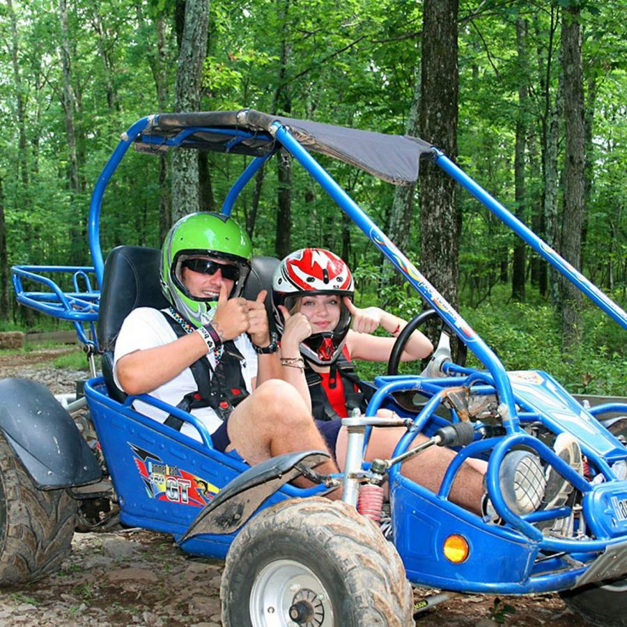 Campers in go karts giving thumbs up