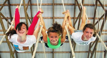 Girls upside down on gymnastics ropes