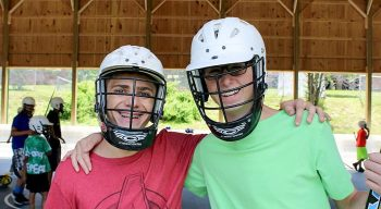boy campers in hockey gear