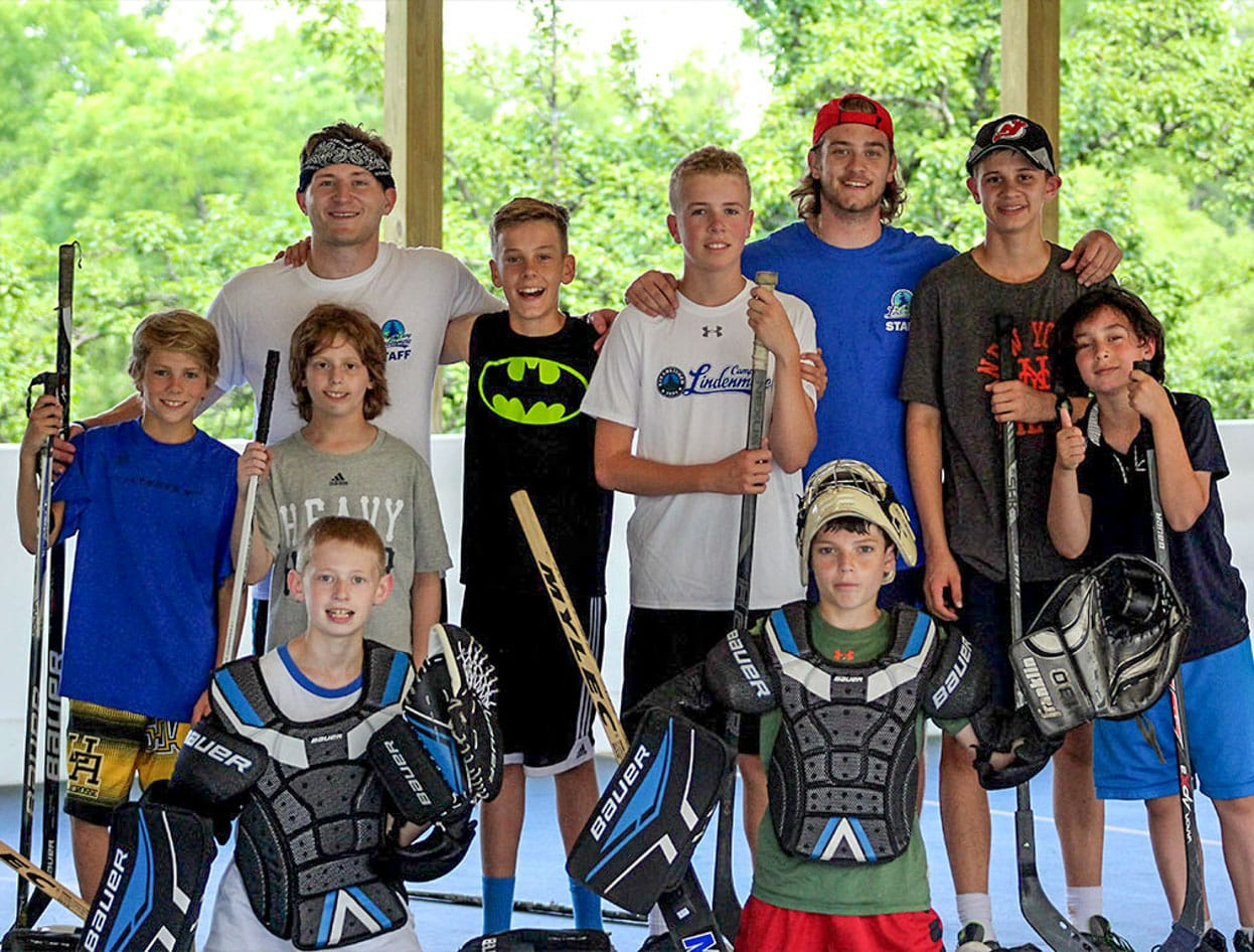 campers and staff with hockey equipment