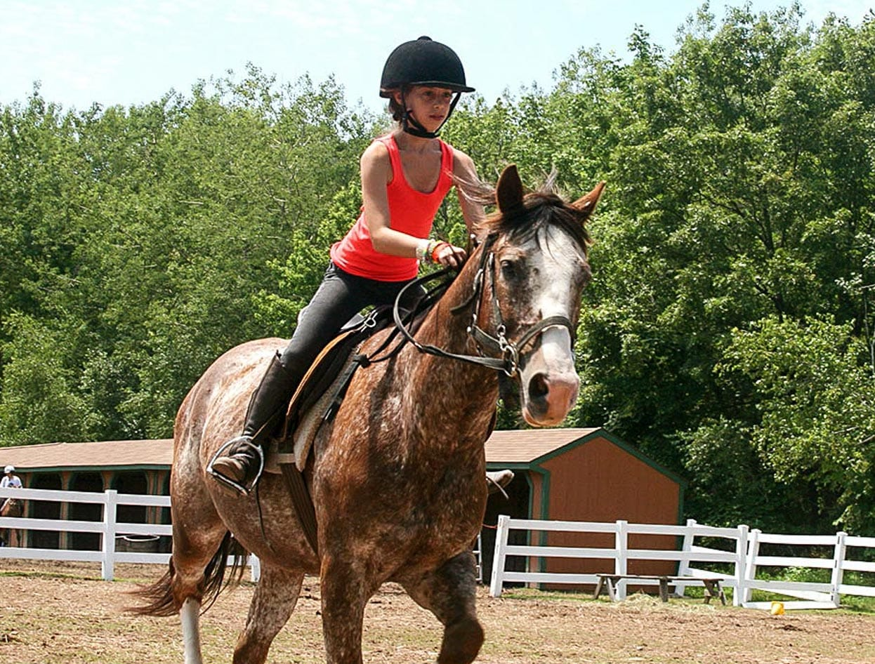 girl camper horseback riding