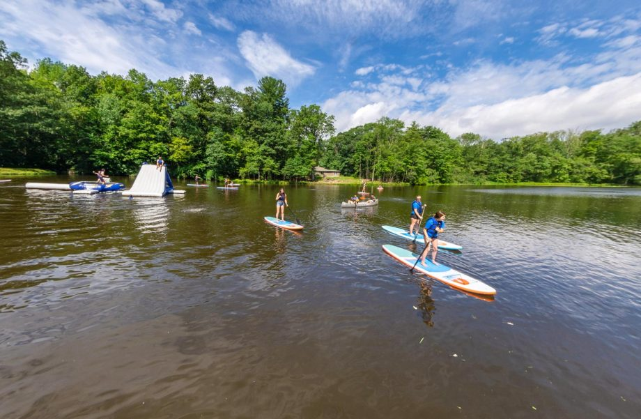 Campers on stand up paddleboards