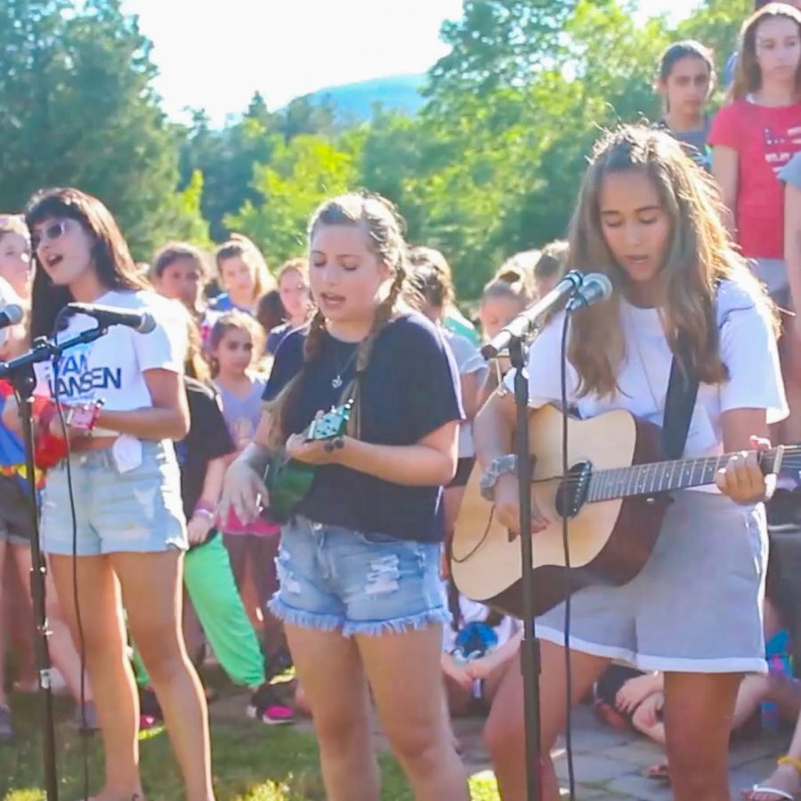 campers and staff playing guitars