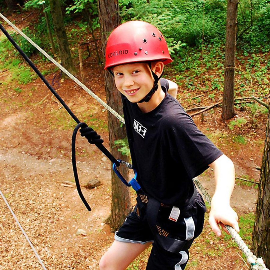 Camper on high ropes course