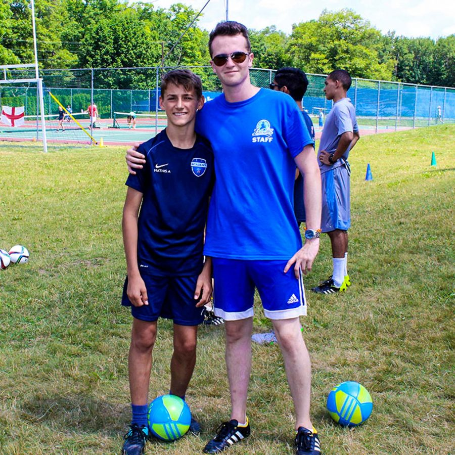 Male staff and camper at soccer