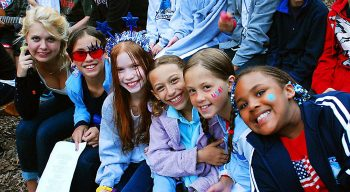 group of smiling campers with facepaint