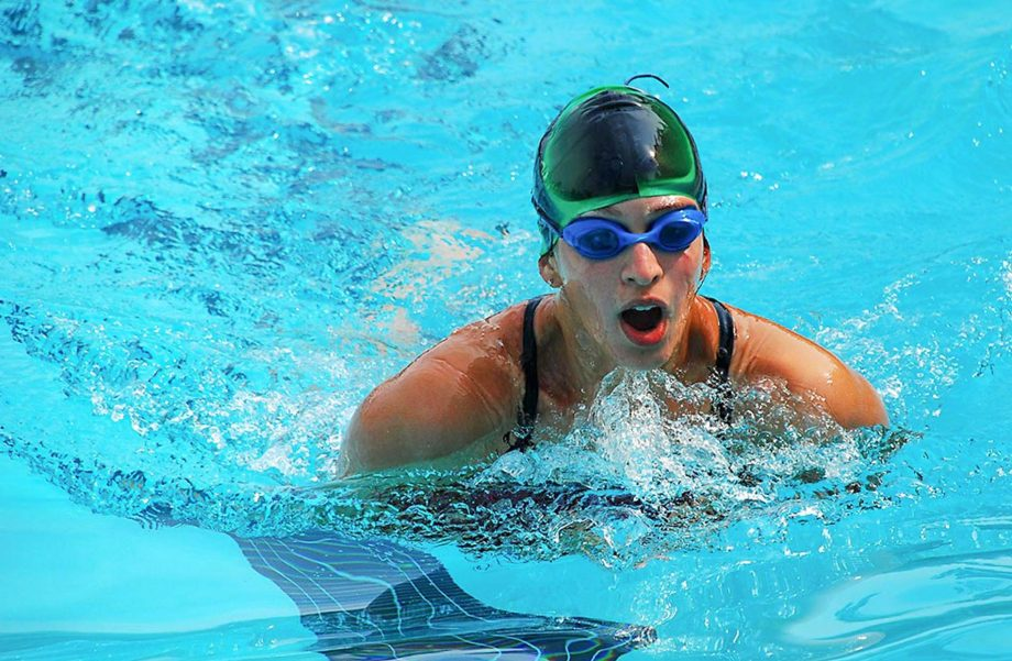 Girl practicing swim stroke
