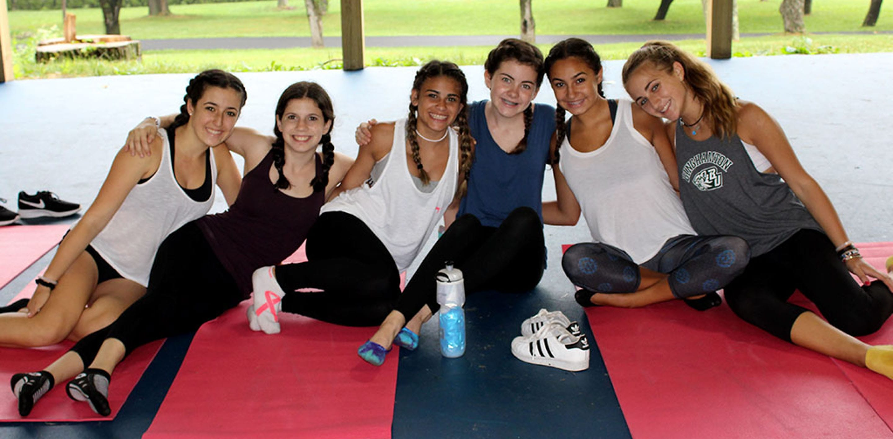 Teen girls sitting on yoga mats
