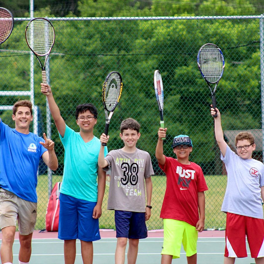 Campers and staff holding tennis racket