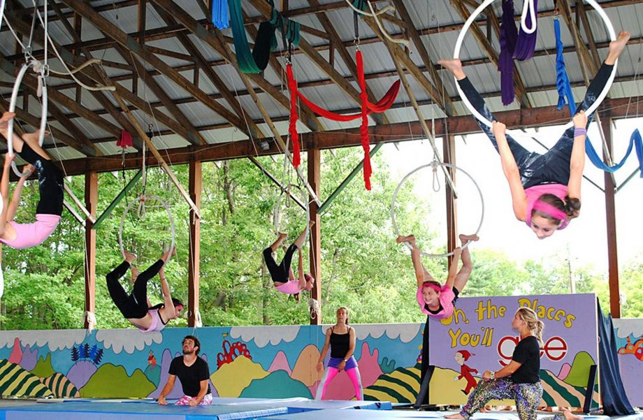 Campers on trapeze rings