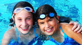 Two girls in swimming pool
