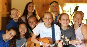 Campers learning to play guitar